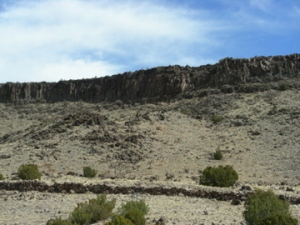 A thick flow of basalt lava capping a mesa near Santa Fe