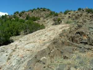 A pegmatite dike intruding ancient crystalline rocks in Northern New Mexico
