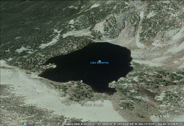 An alpine lake nestled in a cirque and held in place by a terminal moraine dam